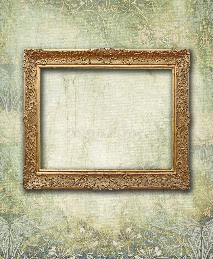 Tömmer den blom- urblekta tapeten för Grunge med guld- antikt ramen fotografering för bildbyråer