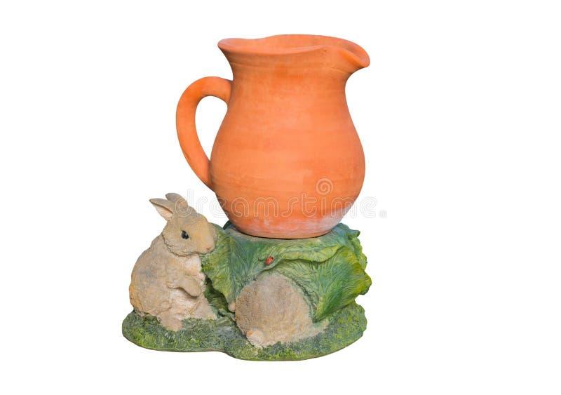 Töpferwarenvase mit Kaninchengips lizenzfreie stockfotografie