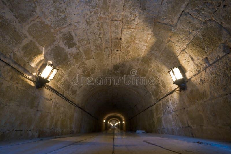 Túnel de pedra com luzes fotografia de stock royalty free
