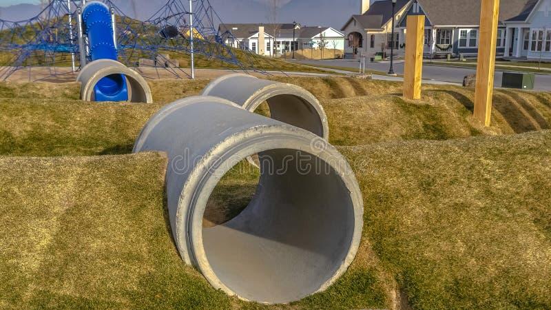 Túneles concretos para el juego en el patio para los niños foto de archivo libre de regalías