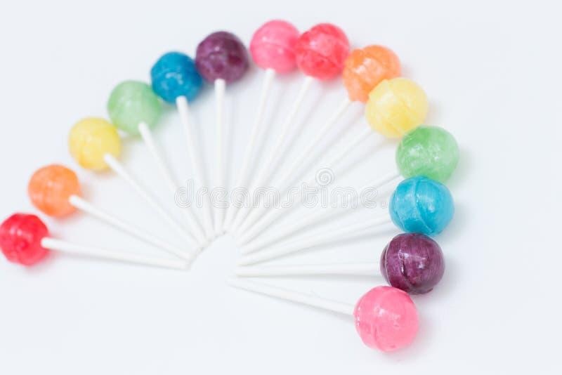 Tęcza projekt słodcy kolorowi lizaki zdjęcie royalty free