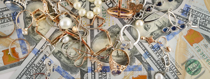 Tła Amerykańscy dolary i biżuteria Mieszkanie nieatutowy, odgórny widok zdjęcia royalty free