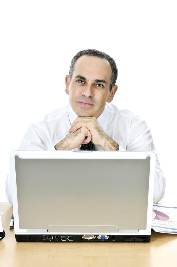 tła biznesmena biurko jego biel obraz stock