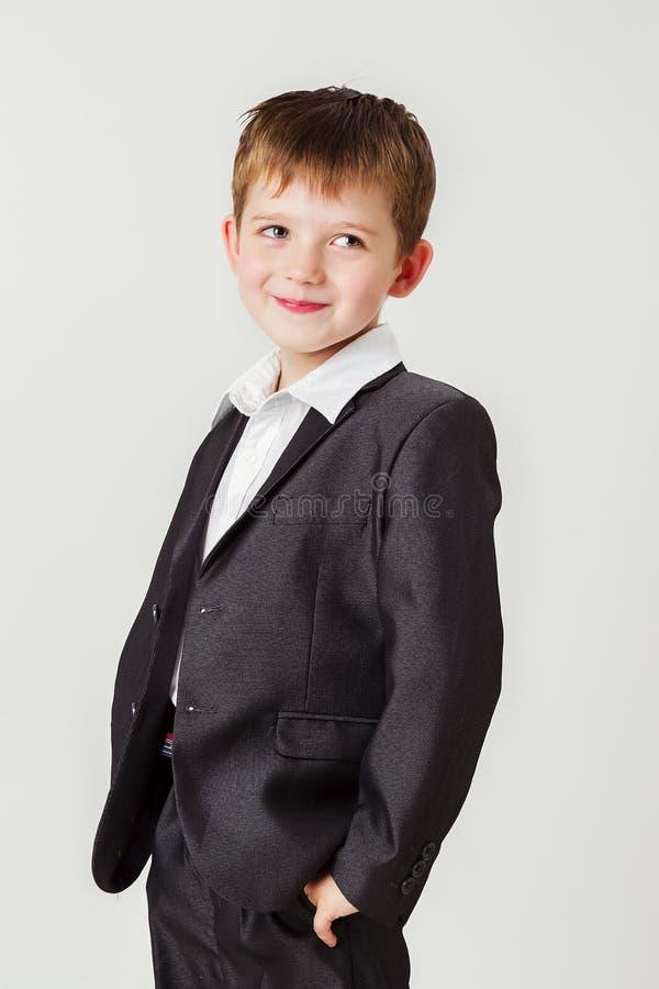 tła chłopiec biznesu odosobniony mały kostiumu biel obraz royalty free