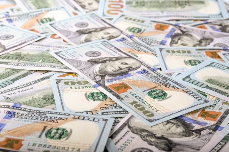 tła dolarów szkło odizolowywał kędziorka target3544_0_ pieniądze s u biel S 100 dolar rachunki zdjęcia stock
