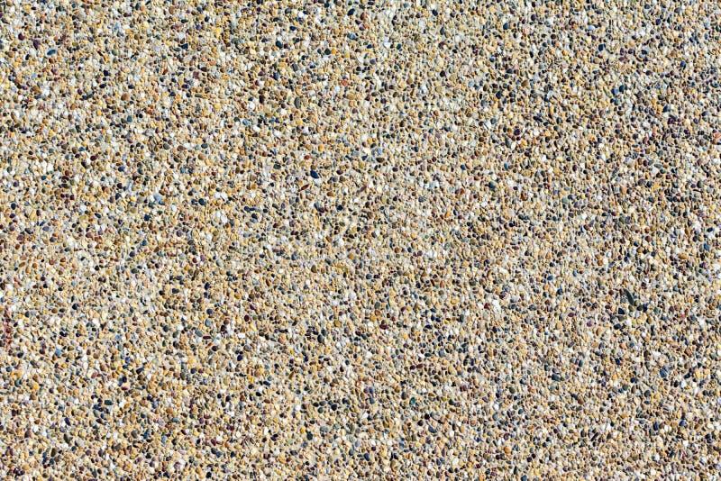 Tła piasek kamienna ściana Mali otoczaki mieszający z piasek texted tłem obrazy stock