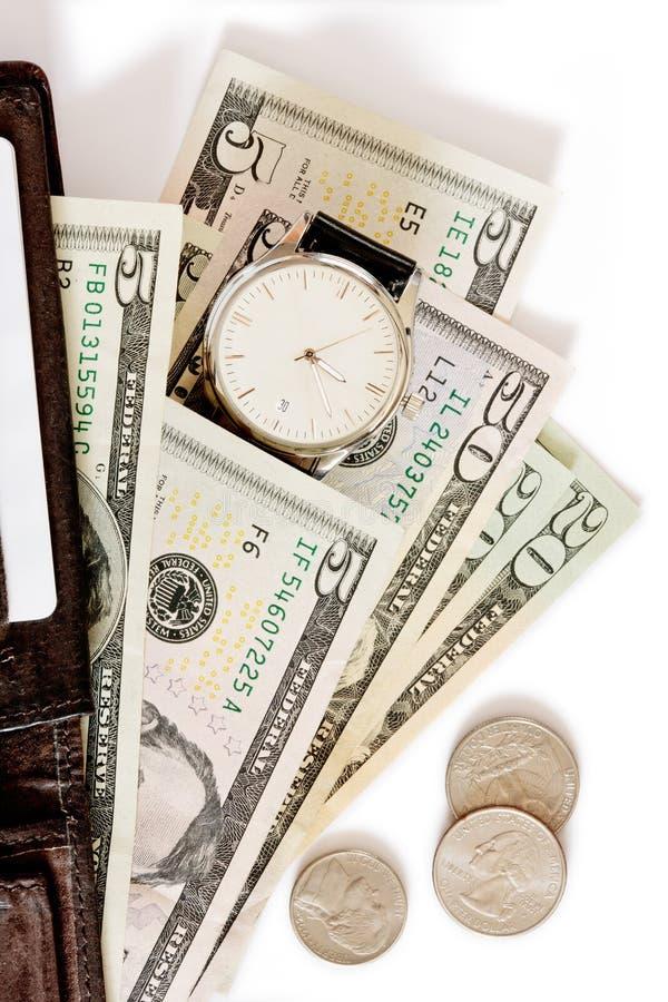 tła pieniądze portfla zegarka biel obraz stock