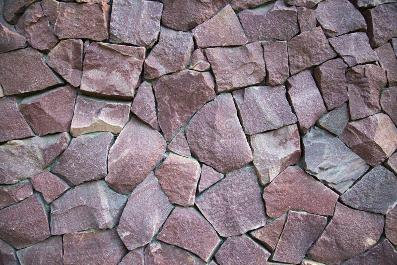 Tło ściana granitowi kamienie nieregularnego kształta lily kolor fotografia stock