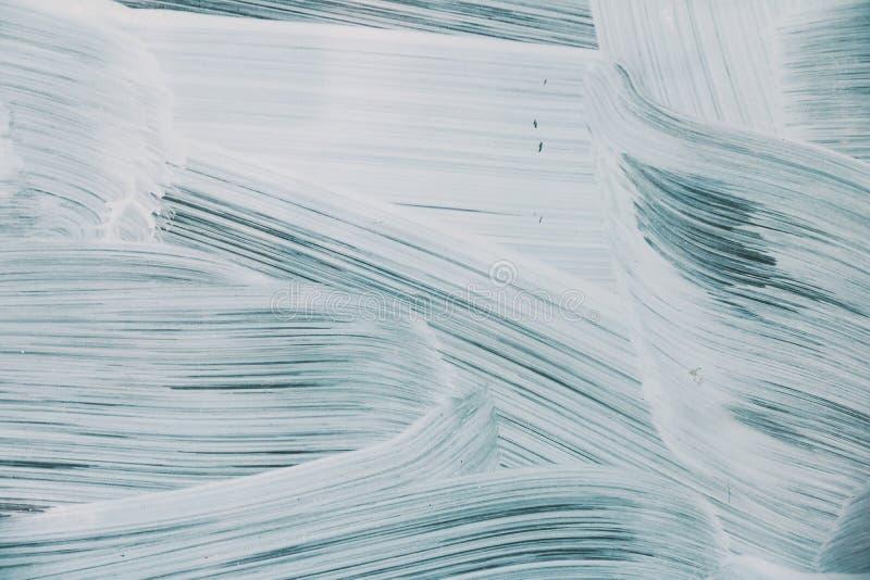 Tło biała farba na błękitnym brushstroke zdjęcia royalty free