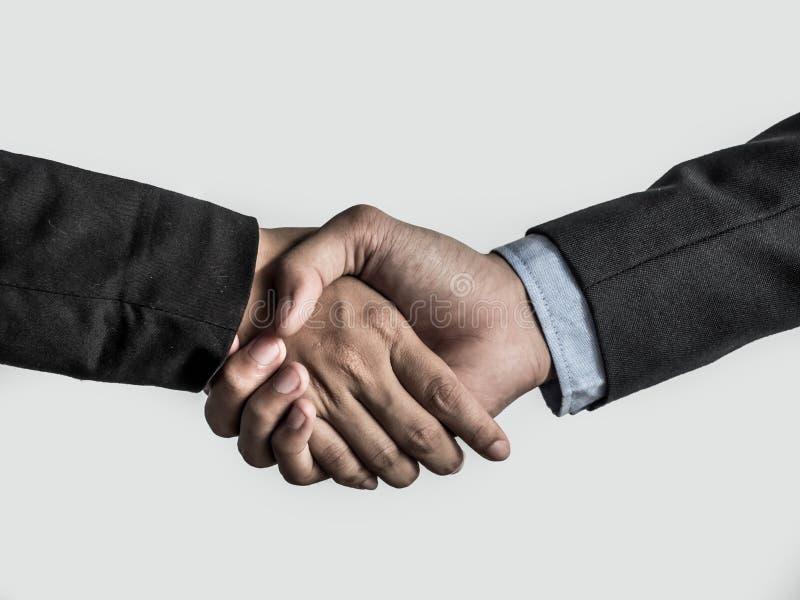 tło biznesmeni wręczają uścisk dłoni odizolowywającą studia dwa biały pracę zdjęcia stock
