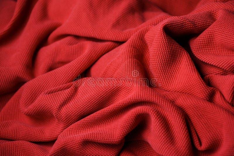 Tło czerwona porowata tkanina zdjęcia stock