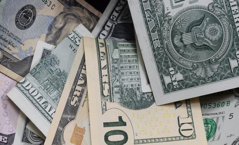 Tło, dolary różna wartość Ups zdjęcia royalty free