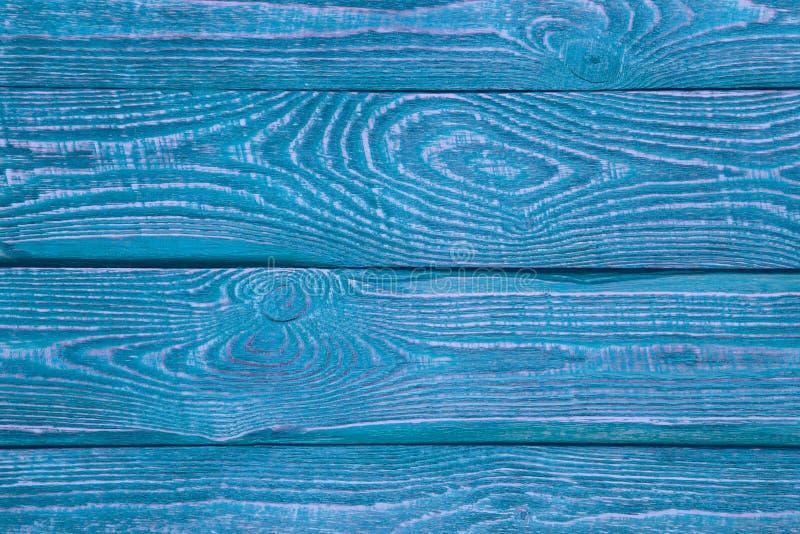 Tło drewniane tekstur deski z odpoczynkiem stary błękitny i purpury malujemy horyzontalny obrazy stock