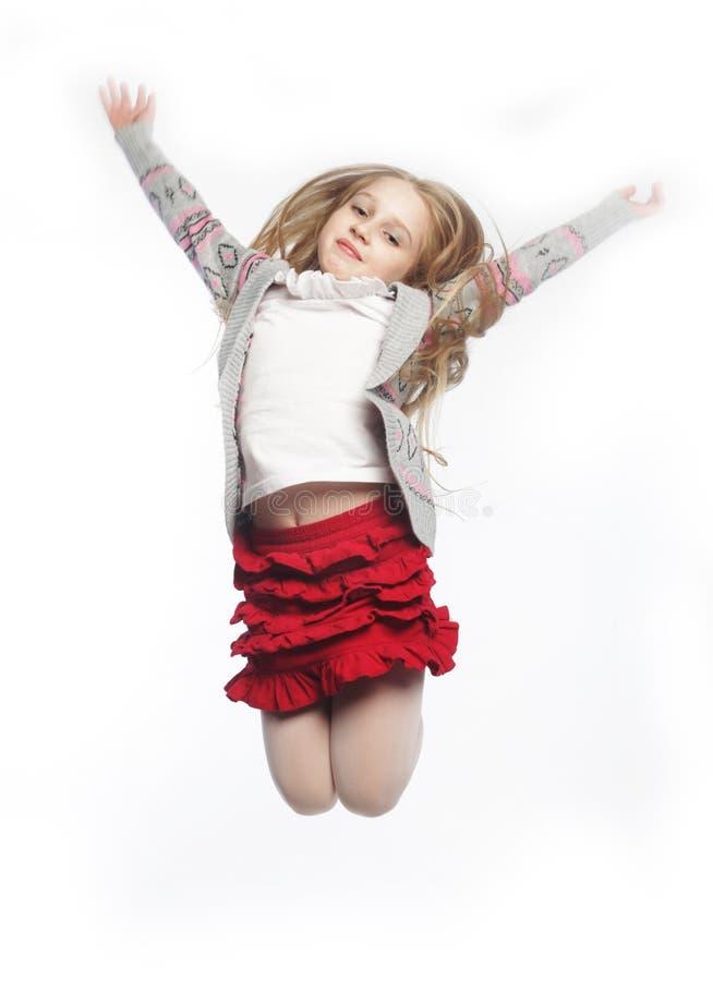tło dziewczyna skacze biel zdjęcie stock