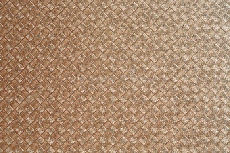 Tło i tekstura złocisty opakunkowy papier obrazy royalty free