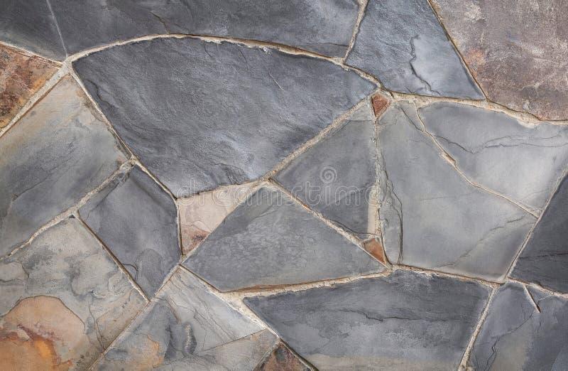 Tło nowożytna kamienna ceglana tekstura, abstrakcjonistyczna piaska lub granitu ściana w naturalnych wzorach dla projekt sztuki p fotografia stock