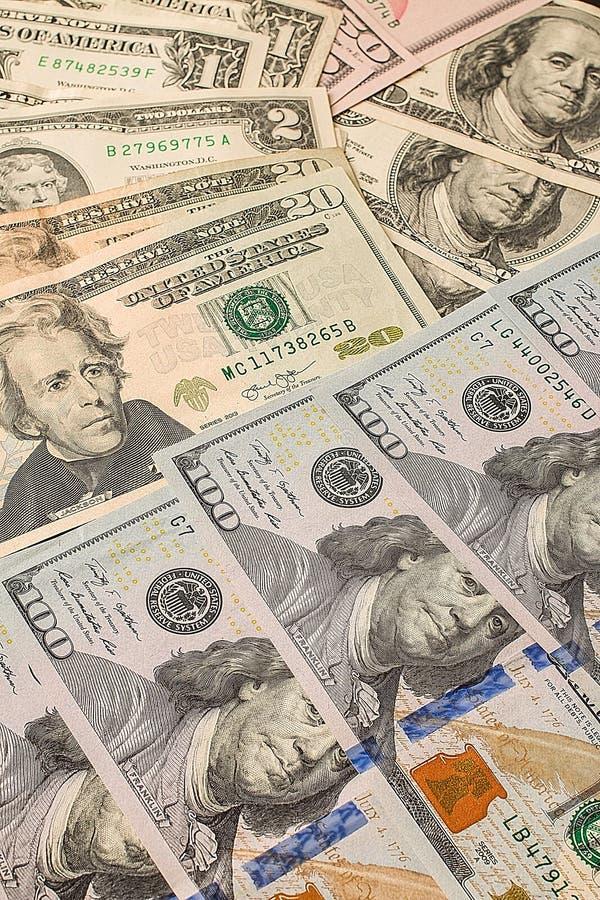 Tło od papierowych dolarów różna przewaga fotografia stock