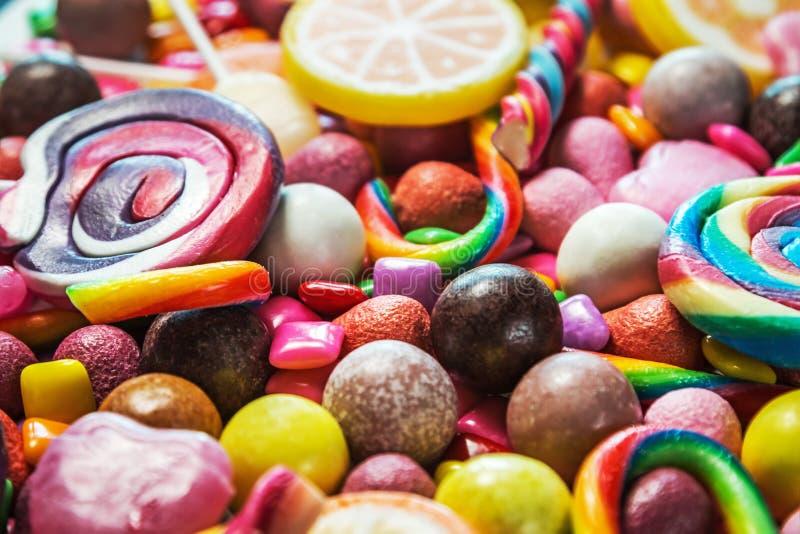 Tło od rozmaitości cukierki, lizaki, guma do żucia obraz royalty free