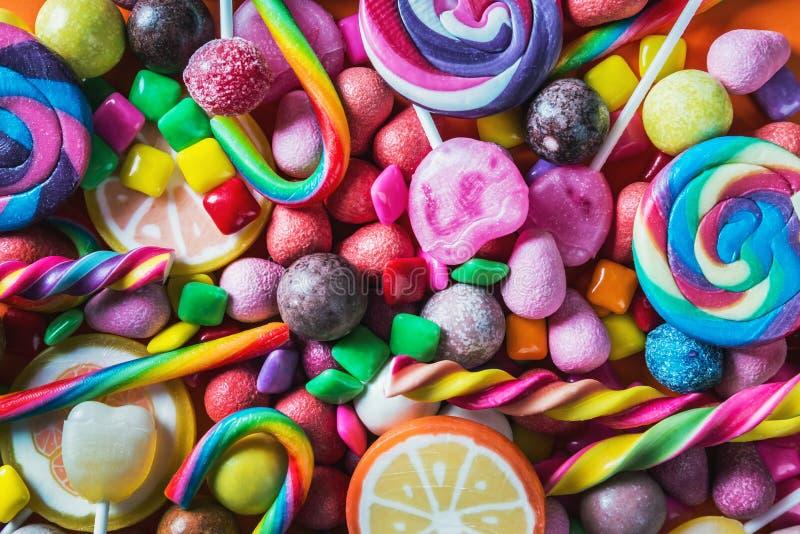 Tło od rozmaitości cukierki, lizaki, guma do żucia obrazy stock