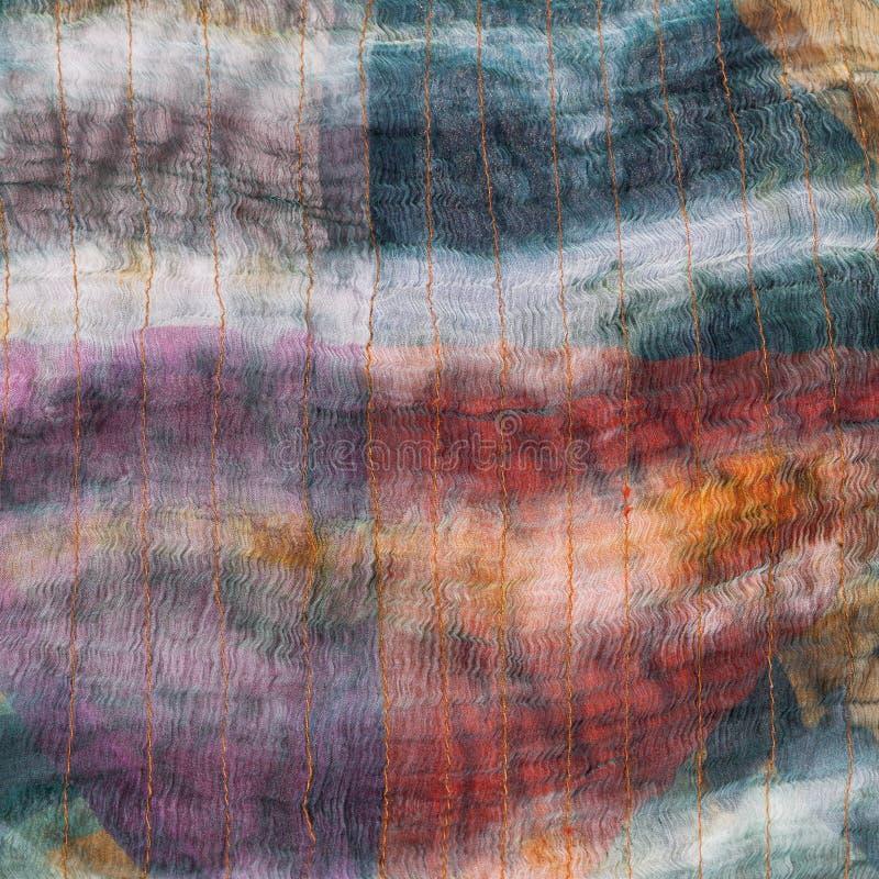 Tło od zaszytego ciemnego jedwabniczego batika obraz stock