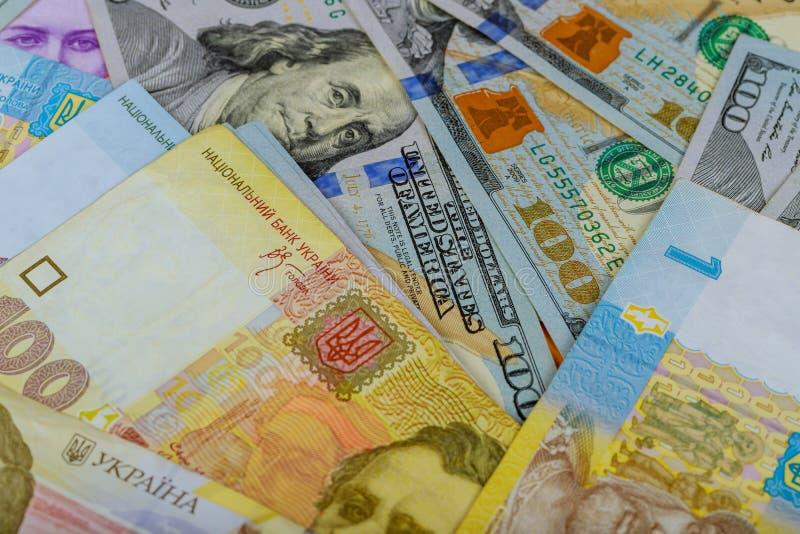 Tło różni banknoty USA dolary i Ukraińscy hryvnias zdjęcia royalty free