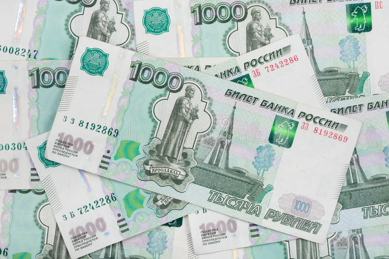 Tło rozrzucony banknotu Rosyjskiego rubla wyznanie tysiąc rubli fotografia royalty free