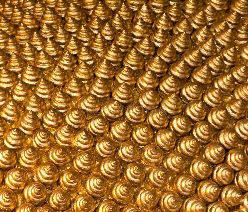tło skręty złoci zdjęcia stock