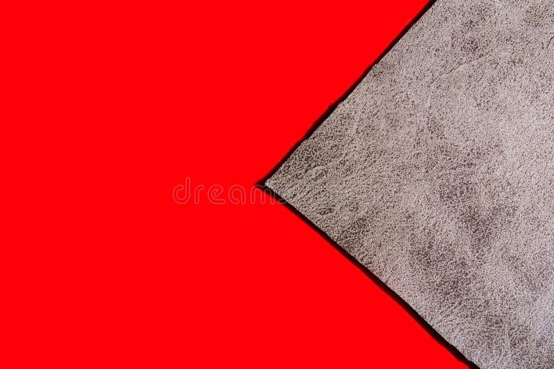 Tło szary płótno na czerwonej powierzchni zdjęcia stock