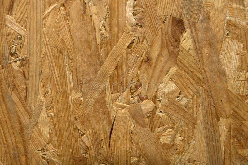 Tło, tekstura drewniany trociny, chipboard obraz stock