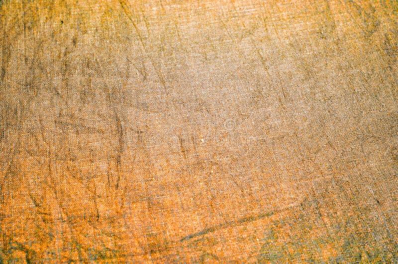 Tło tekstura, wzór Zwarta bawełniana tkanina z złocistym kolorem zdjęcie royalty free