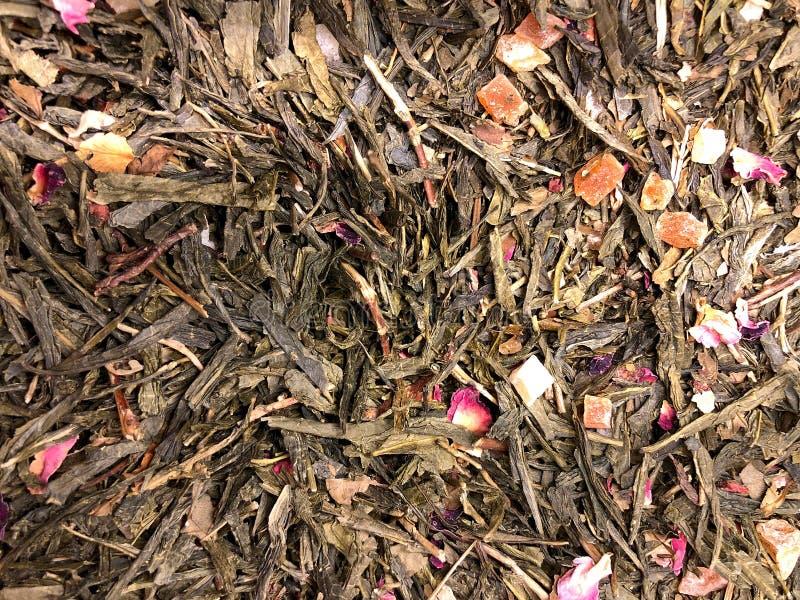 Tło tekstury luźnego liścia truskawkowa ananasowa zielona herbata zdjęcie stock