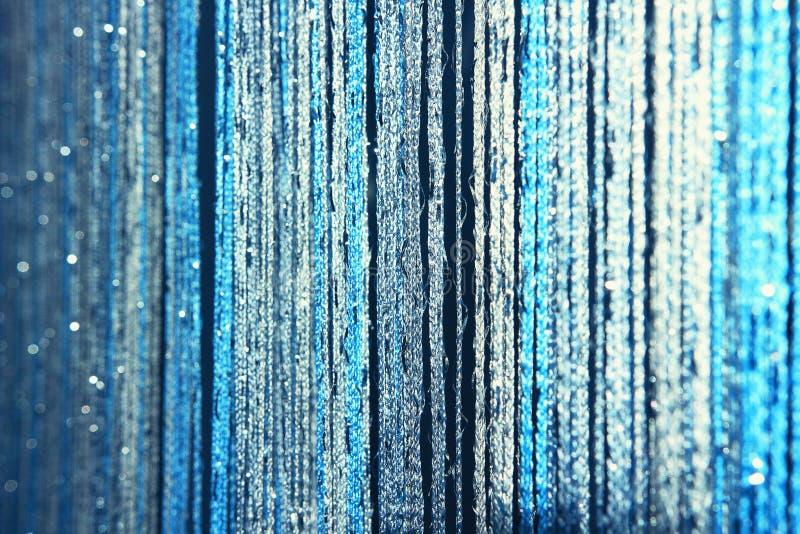 Tło tekstury zasłony robić błękitne nici z błyskotliwością i plamą przy krawędziami zdjęcie stock