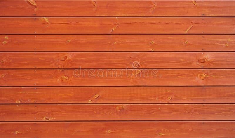 tło wsiada pomarańcze drewnianej fotografia stock