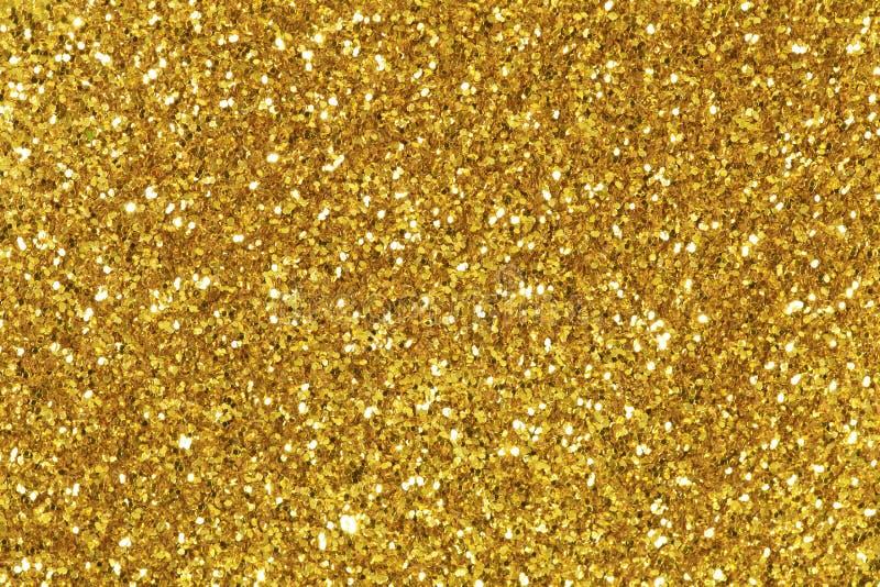 Tło wypełniający z błyszczącą złocistą błyskotliwością zdjęcia stock