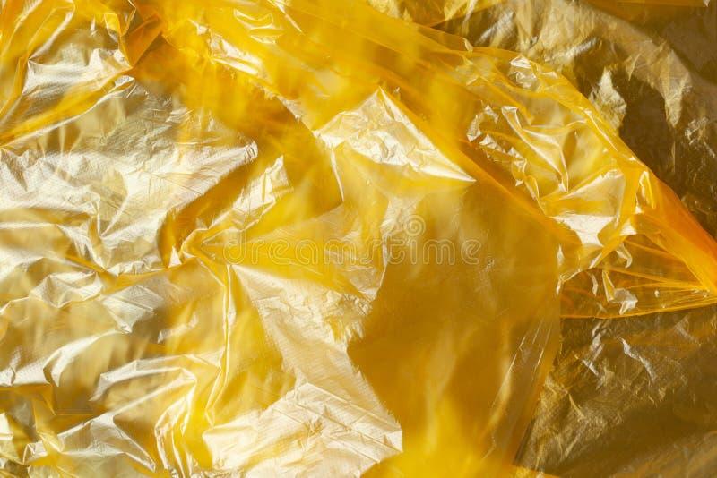 Tło z żółtego polietylenu nadającego się do recyklingu Eco, zero odpadów, alternatywa dla plastiku Płaska warstwa Poziomo Zbliżen zdjęcia royalty free