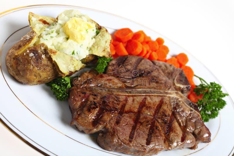 T-bone steak dinner stock photo