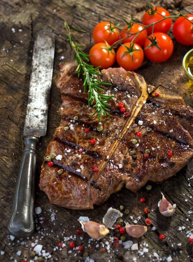 T-Bone Steak. On wooden background stock images
