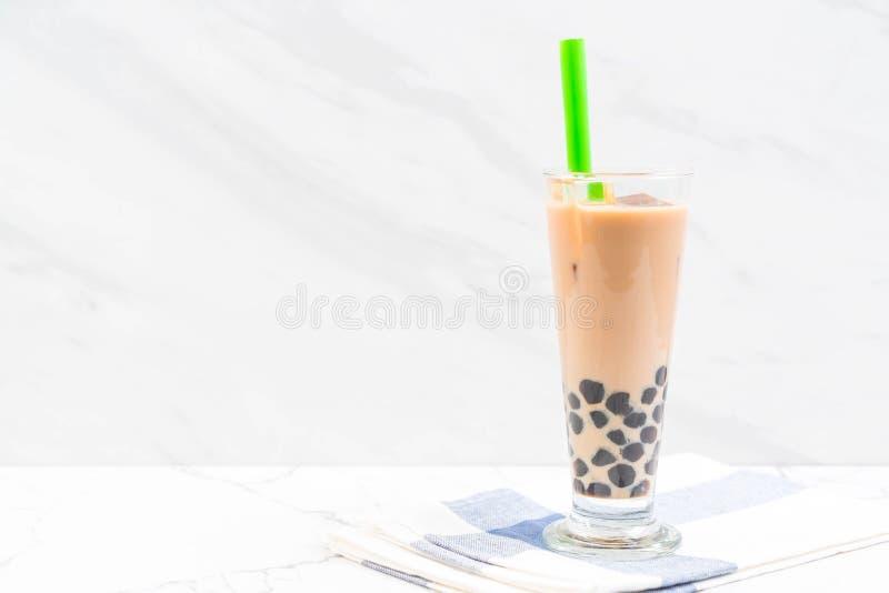 T? de la leche con la burbuja imagenes de archivo