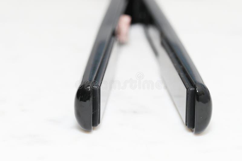 T3 1' de passe simple redressant et dénommant le fer photographie stock