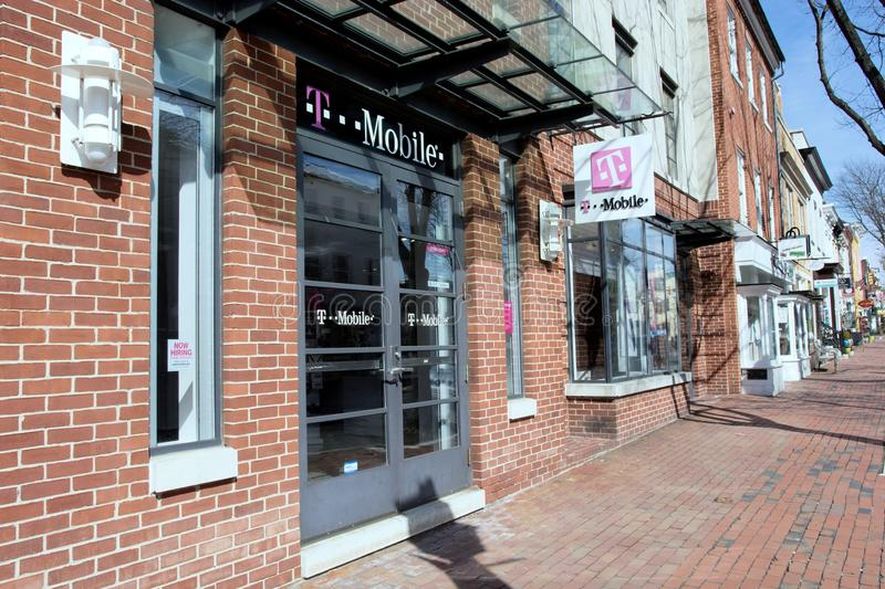 T-Mobile in Old Town Alexandria, Virginia. T-Mobile provides wireless voice, messaging, and data services in the United States. Photo takeon March 17th, 2015 stock image