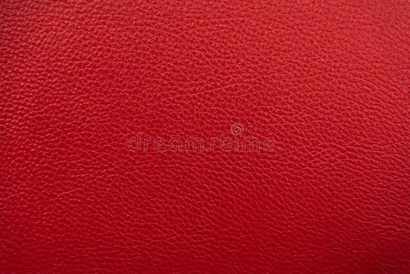 t?o tekstura rzemienna czerwona Luksusowej prawdziwej tkaniny powierzchni materialna tapeta z meblarskim t?em Zamyka w górę mody zdjęcie royalty free