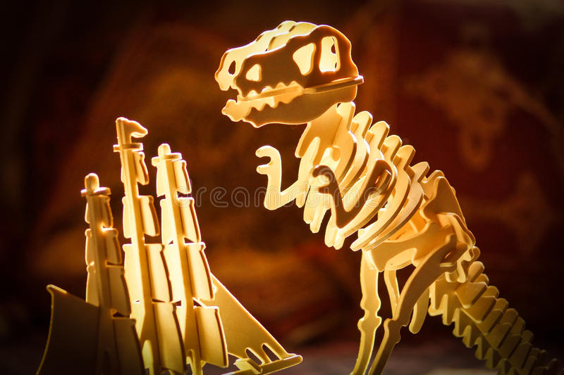 T-Rex attacks ship. Tyrannosaurus Rex prepares to attack sailing ship. 3D puzzle scene with dramatic back lighting stock images