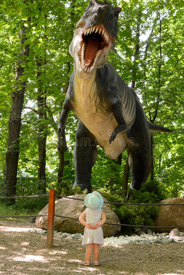 T-Rex dinosaur. Huge T-Rex dinosaur and a baby watching. Picture taken in Dinosaur Park in Lesser Poland royalty free stock image