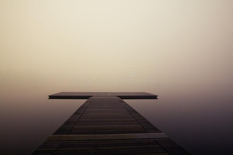 T shaped jetty in fog royalty free stock image