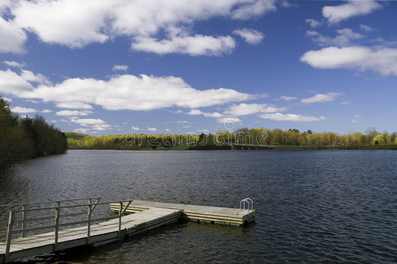 T-shaped Pier on Lake. A swimming pier on a Lake in Cowansville, Quebec, Canada royalty free stock image
