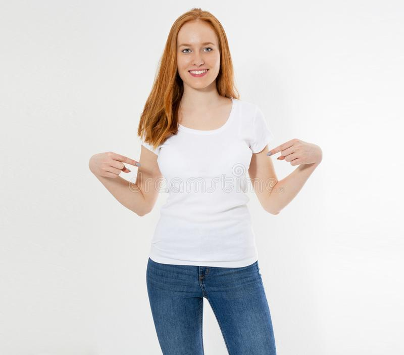 T-shirt design and advertising concept. Style and fashion. Indoor shot of cheerful smiling youngred head woman with red hair. Pointing index finger at copy royalty free stock images