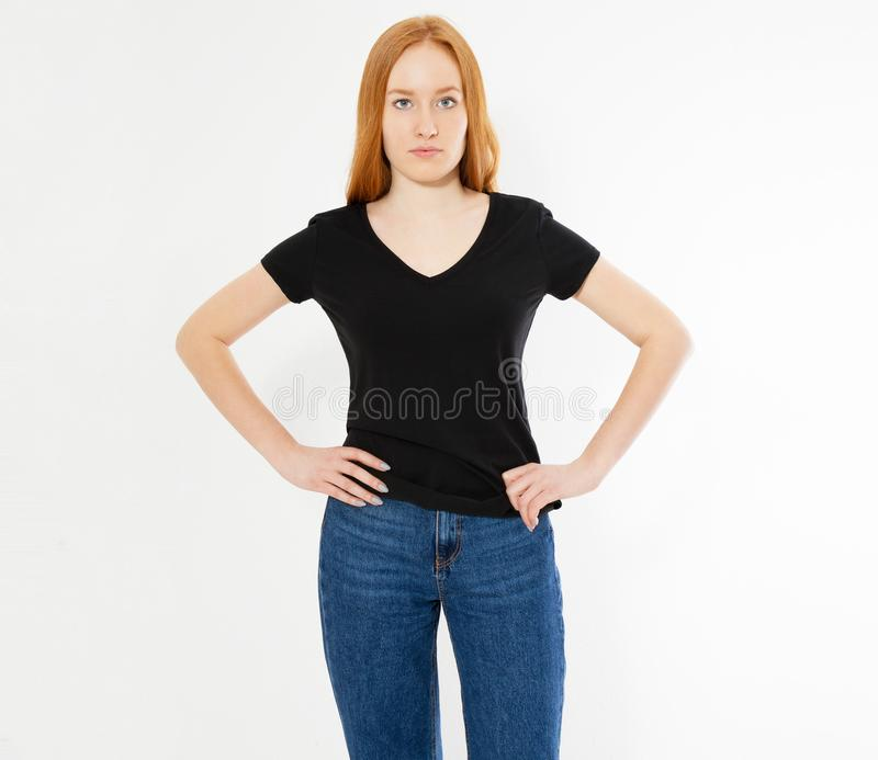 T-shirt design, happy people concept - smiling red hair woman in blank black t-shirt pointing her fingers at herself, red head royalty free stock photography