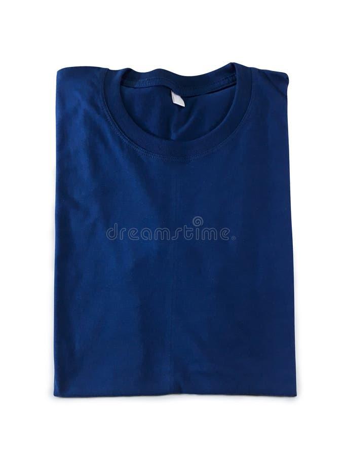 T-shirt dobrado dos azuis marinhos Trajeto de grampeamento fotografia de stock royalty free