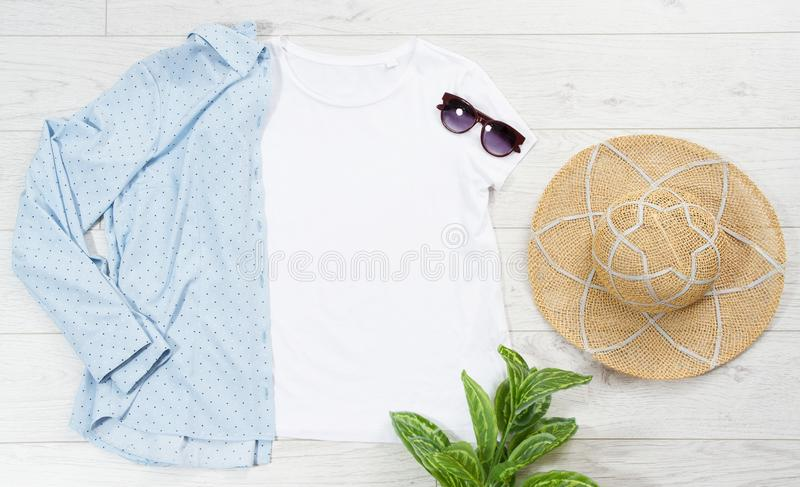 T-shirt mock up, blue shirt sun glasses empty bag summer hat top view, copy space mockup royalty free stock photos