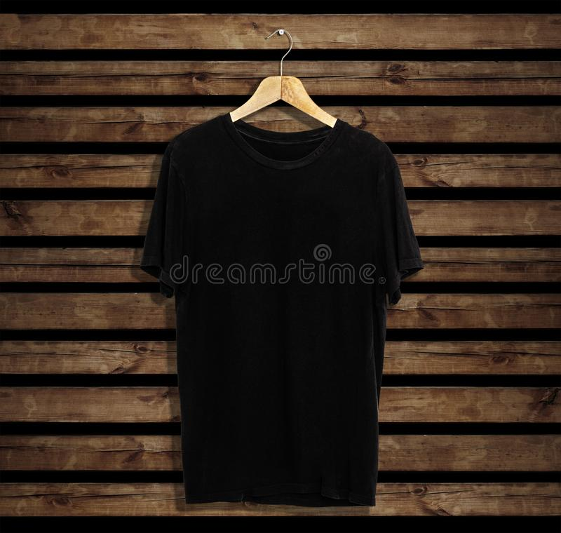 T-shirt mockup and template on wood background for fashion and graphic designer. T-shirt mockup for fashion designer stock photography
